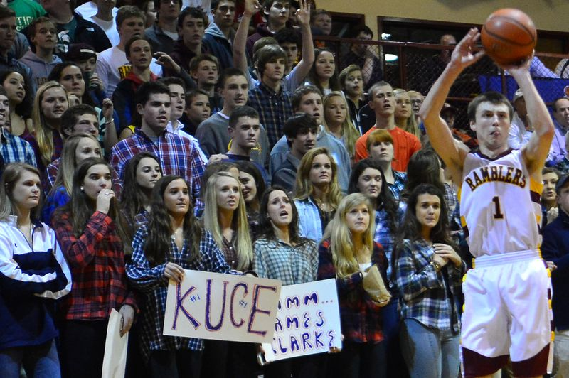 Loyola fans watch Kevin Kucera as he shoots a three against St. Viator.