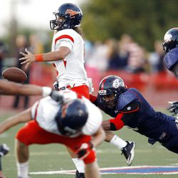 Mountain Crest's #5 Jamison Webb, top left, is hit by Woods Cross' #5 Filipo Mokifisi and loses the ball during game action Friday, Aug. 31, 2012.