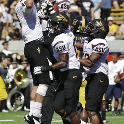 Arizona State wide receiver Kevin Ozier, top center with ball, celebrates with quarterback Taylor Kelly, top left, after Oizer's touchdown reception against California during the first half of an NCAA college football game in Berkeley, Calif., Saturday, Sept. 29, 2012. (AP Photo/Marcio Jose Sanchez)