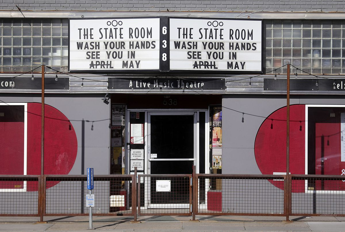 Workers at The State Room in Salt Lake City, pictured on Wednesday, April 1, 2020, crossed out April and replaced it with May on its marquee due to extended social distancing measures during the COVID-19 pandemic.
