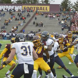Toledo defenders hold up Willie Reid as Ronnie Jones attempts to slip through incoming gunners on a kickoff return.
