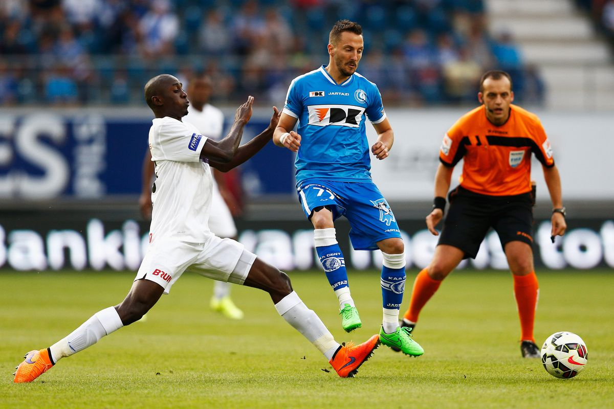 Wilfred Ndidi (left) wins a tackle in a match against Gent.