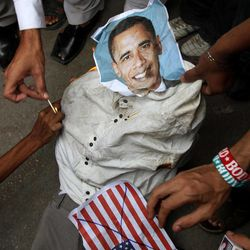 Supporters of a Insaf Student Federation burn an effigy of U.S. President Barack Obama and a representation of a U.S. flag demonstration in Karachi, Pakistan on Saturday, Sept. 15, 2012 as part of widespread anger across the Muslim world about a film ridiculing Islam's Prophet Muhammad.