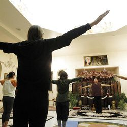 Sri Hanuman Das, right,  leads a yoga class at the Hare Krishna Temple in Spanish Fork  Sunday, Nov. 20, 2011.  The class is for people in the community, from troubled teens to pre-missionaries and not just stretching and downward dog, but a chance to renew and find greater connection to God.