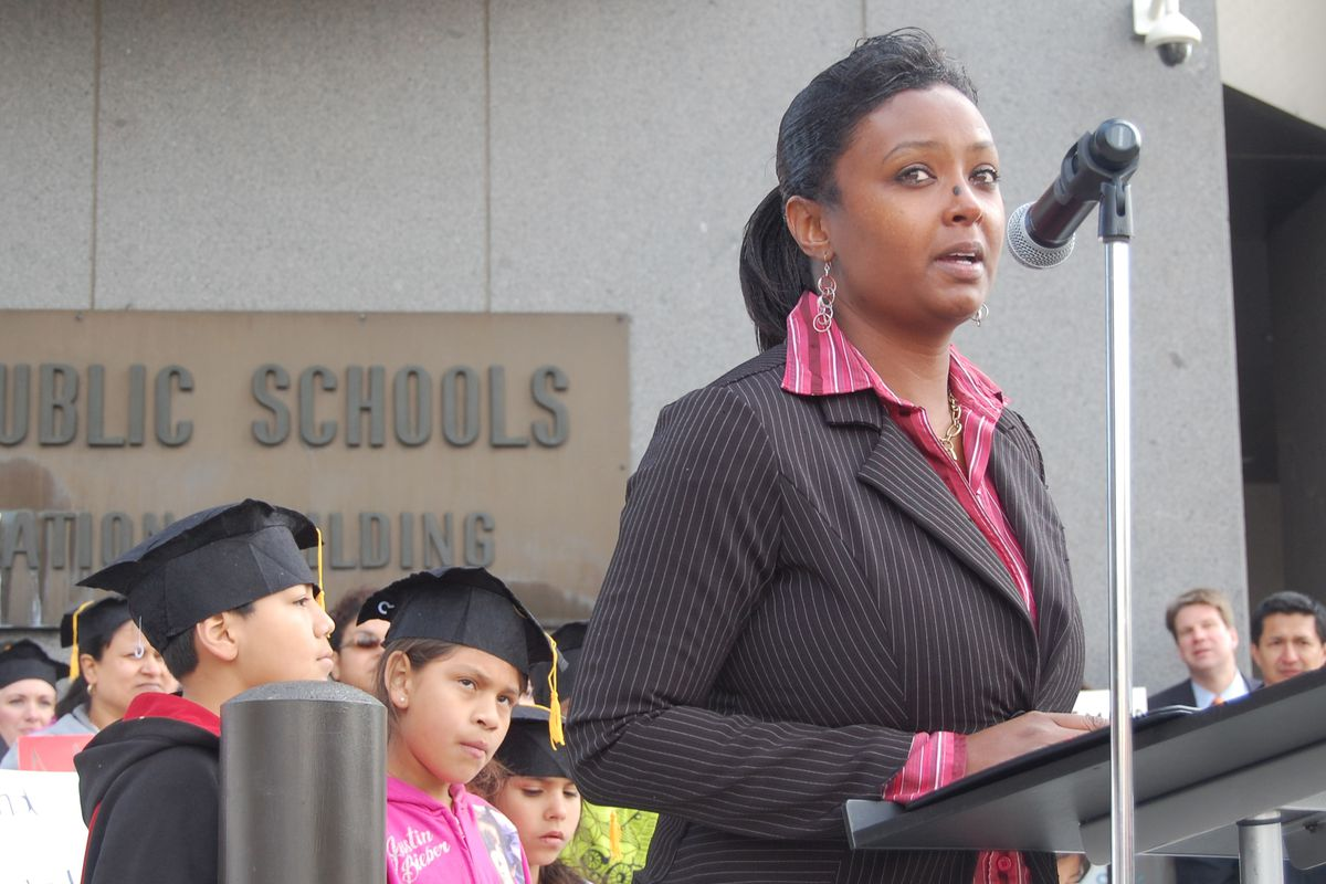 DPS parent MiDian Holmes spoke at a Thursday rally supporting the district's reform proposals.
