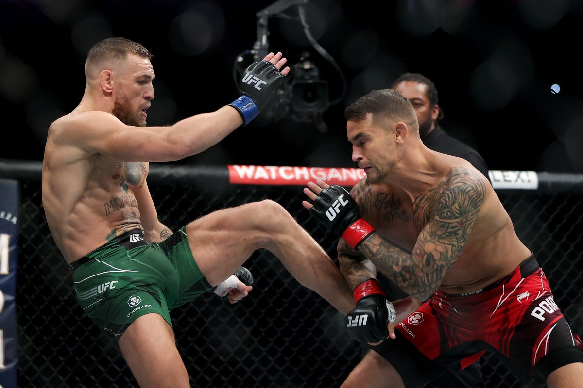 Conor McGregor attempts a body kick against Dustin Poirier in the main event of UFC 264.