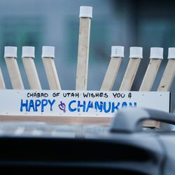 A menorah sits on the roof of a vehicle before aHanukkah parade through Salt Lake City on Sunday, Dec. 13, 2020. The event was organized byChabad Lubavitch of Utah.