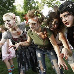 """Zombie Walk participants Molly Shadrick, left, Malorie McDaniel, Kenzie Hamblin and """"Ms."""" Voos stroll the streets of Salt Lake City on Sunday."""