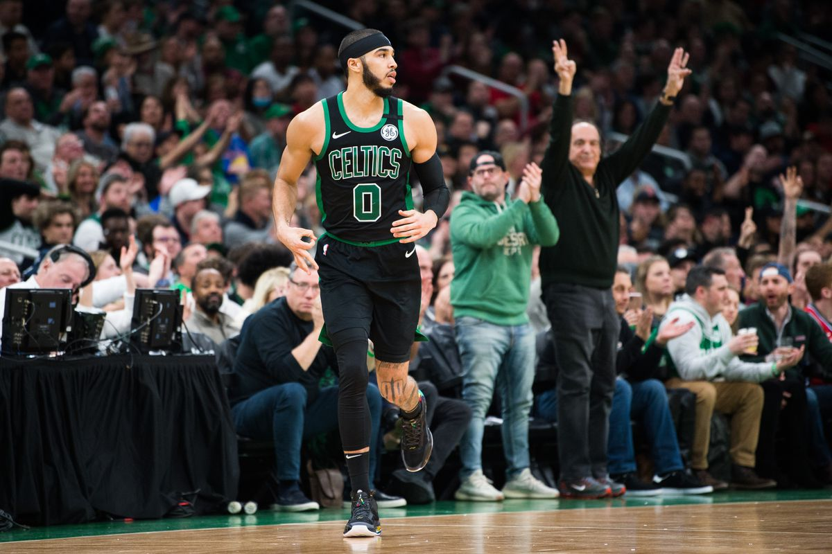 Jayson Tatum of the Boston Celtics reacts after hitting a three pointer in the first half against the Philadelphia 76ers at TD Garden on February 1, 2020 in Boston, Massachusetts.