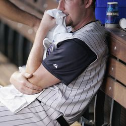 Webb's secret diet of towel was a key component of his success, as seen here in the dugout against the Colorado Rockies on July 31, 2004 at Coors Field
