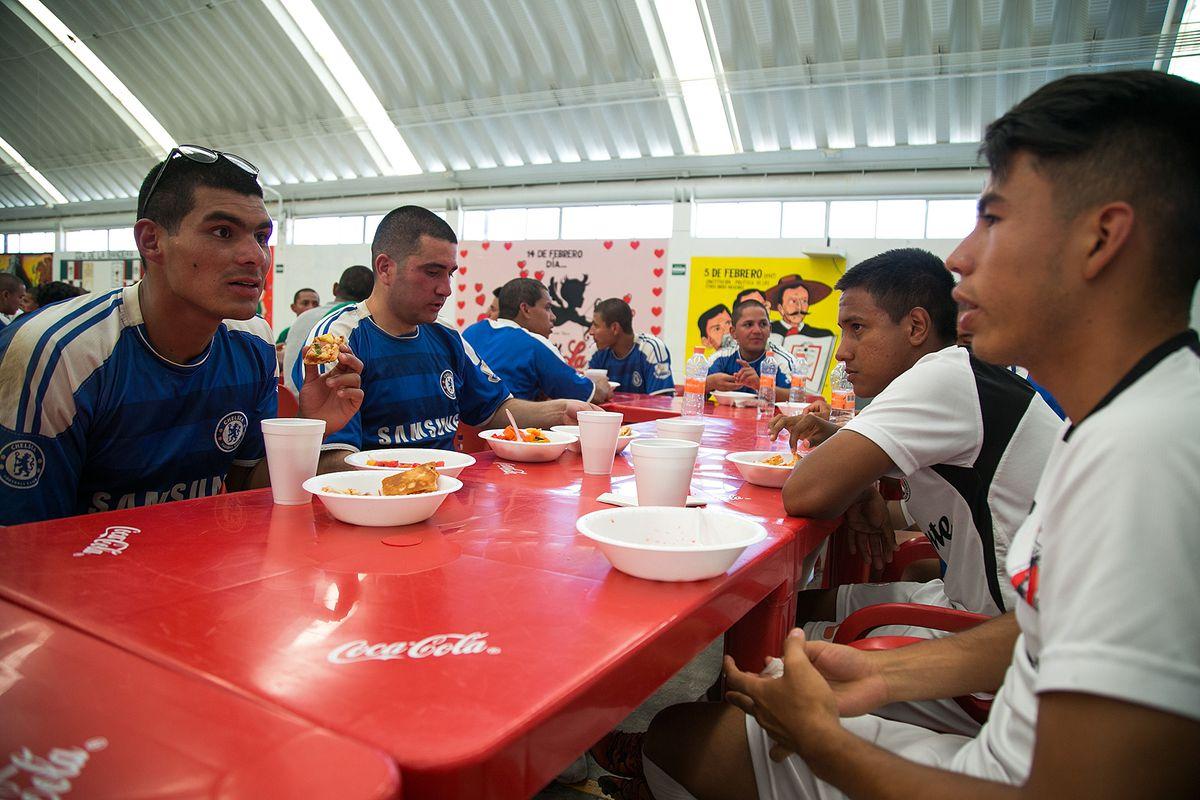 Club Tijuana reserves players eat a meal with young men at Centro de Reinsercion Social Hongo II.