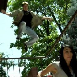 """Jonathan Decker, playing Jono in the film """"CTU: Provo,"""" leaps a fence as he tries to catch a foe."""