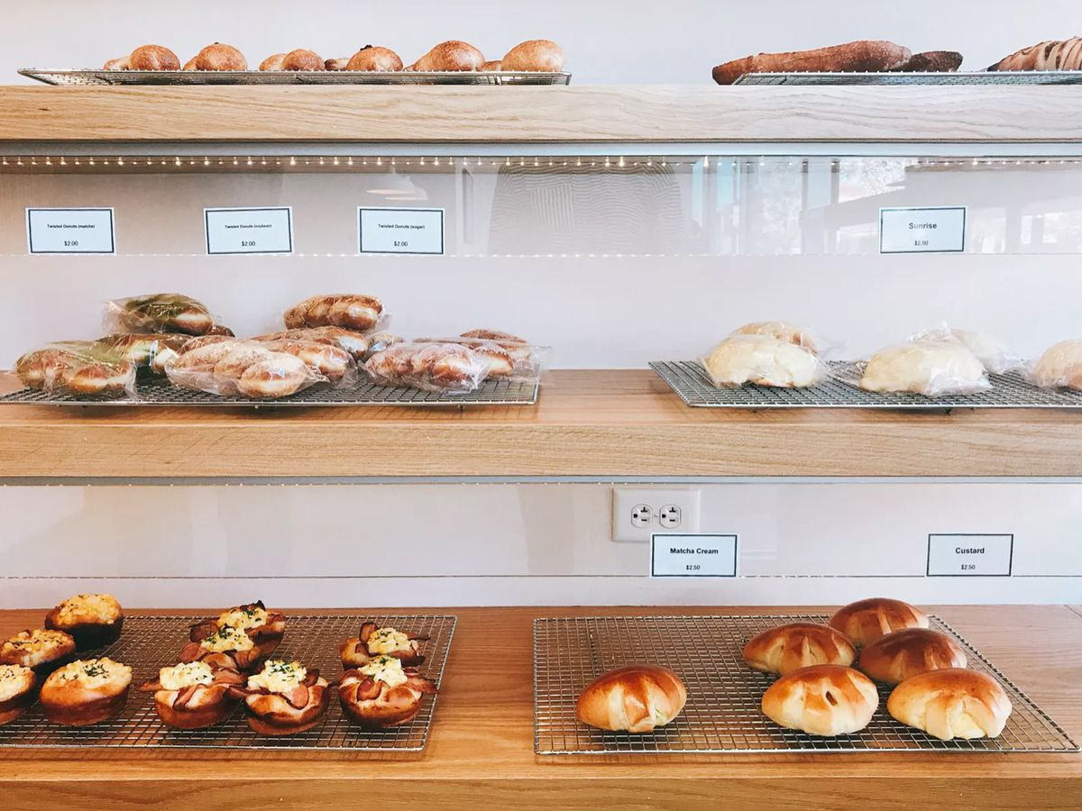 A glass case filled with pastries from Tokyo Premium Bakery