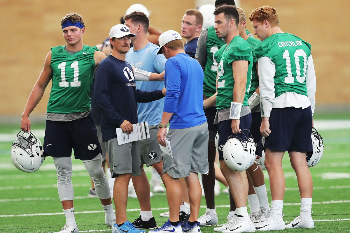Passing game coordinator and quarterbacks coach Aaron Roderick gathers his players after a walkthrough in their indoor practice facility in Provo on Friday, Aug. 10, 2018. Roderick, who this week was promoted to offensive coordinator, says the QB position is wide open heading into spring camp.