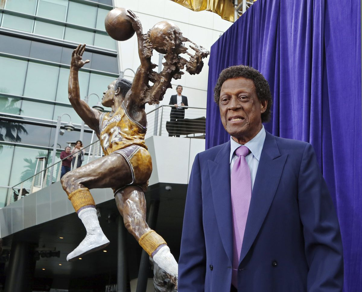 Elgin Baylor stands next to his statueoutside Staples Center.