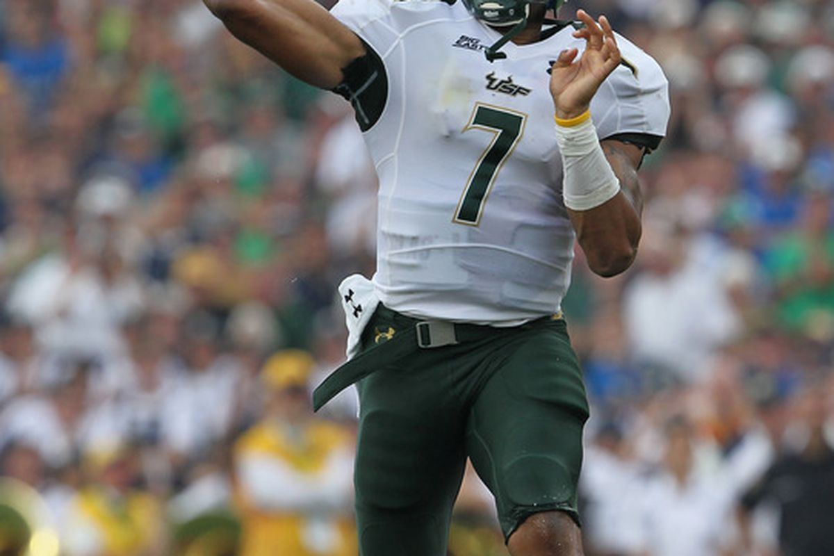 SOUTH BEND, IN - SEPTEMBER 03:  B.J. Daniels #7 of the University of South Florida Bulls throws a pass against the Notre Dame Fighting Irish at Notre Dame Stadium on September 3, 2011 in South Bend, Indiana.  (Photo by Jonathan Daniel/Getty Images)