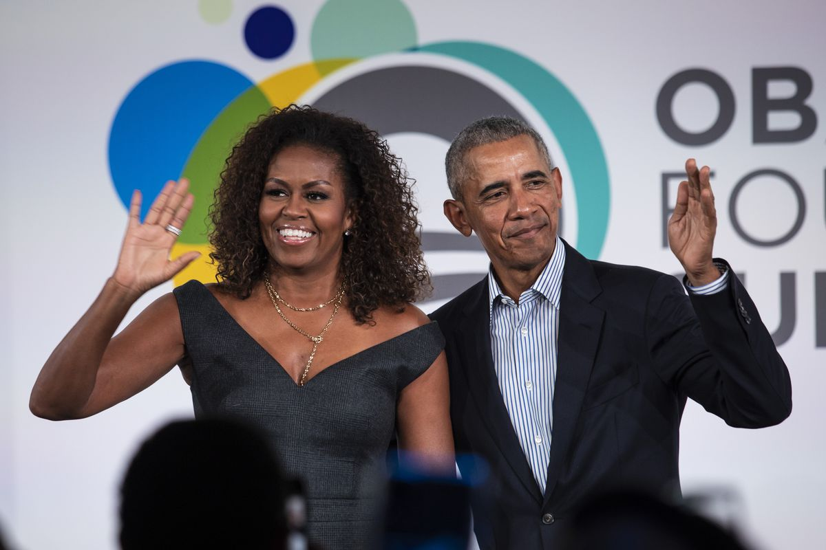 Former President Barack Obama and first lady Michelle Obama appear on stage together after the Obama Foundation Summit at the Illinois Institute of Technology in 2019.