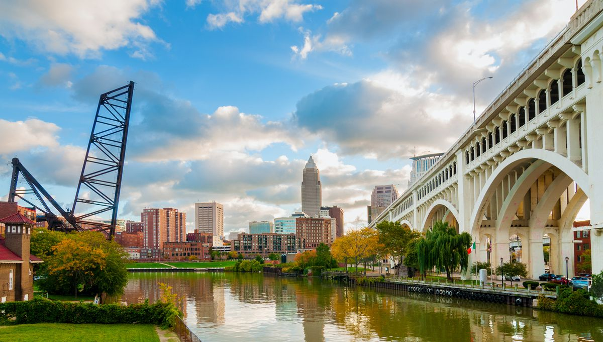 The Cuyahoga River bends past downtown Cleveland by the Veterans Memorial Bridge.