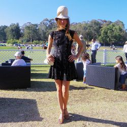 Katharine O'Brien in a vintage hat from What Goes Around Comes Around, an Isabel Marant dress, Fendi heels and a Chanel bag.