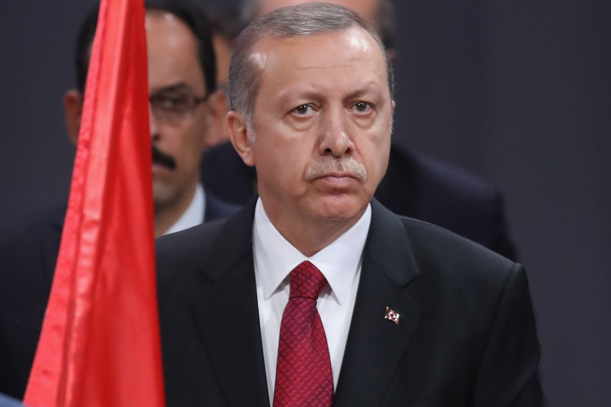 Turkish President Recep Tayyip Erdogan observes a ceremony to honor NATO soldiers killed in the line of duty.