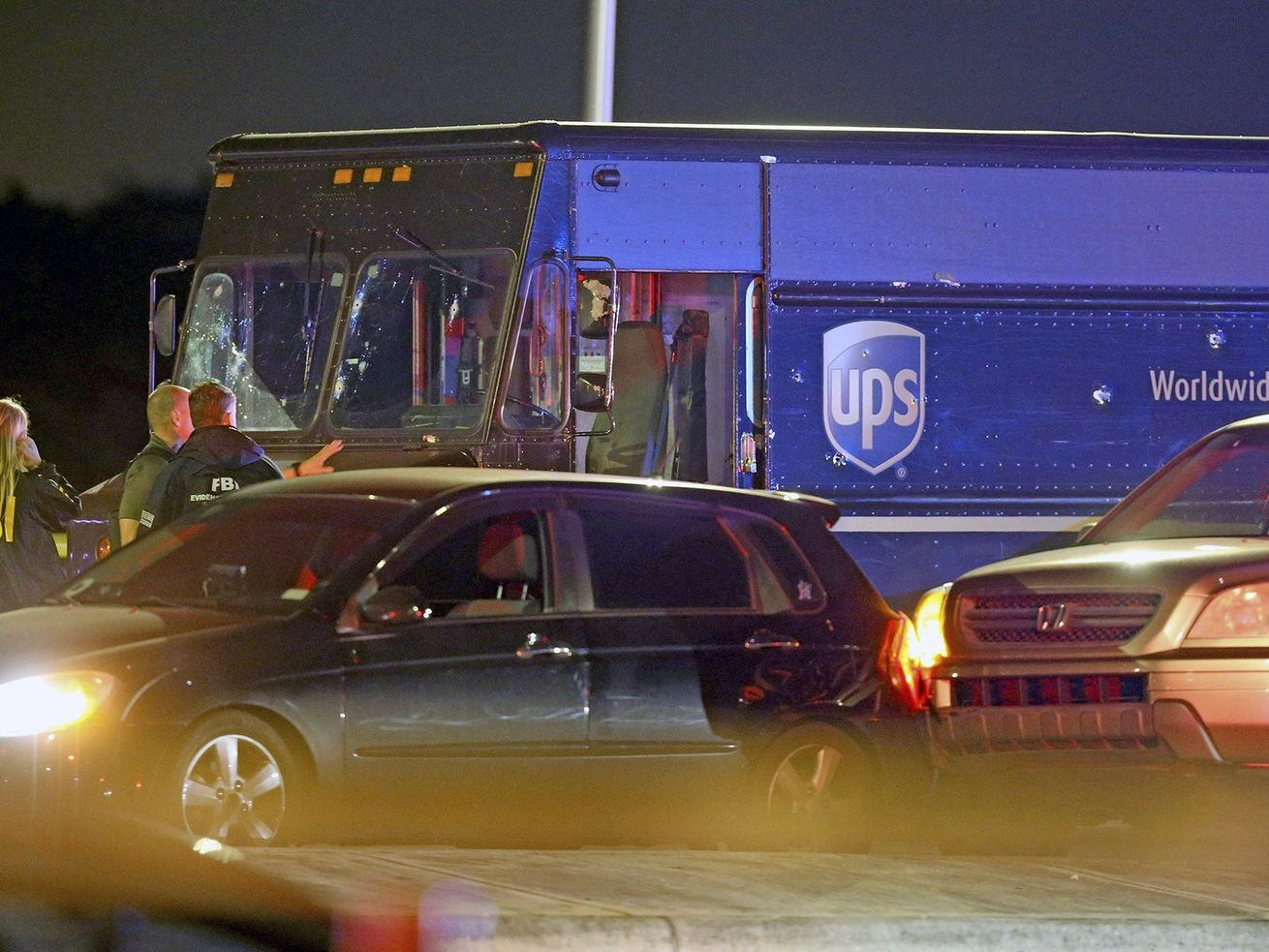 Chase with stolen UPS truck ends with shootout, four dead