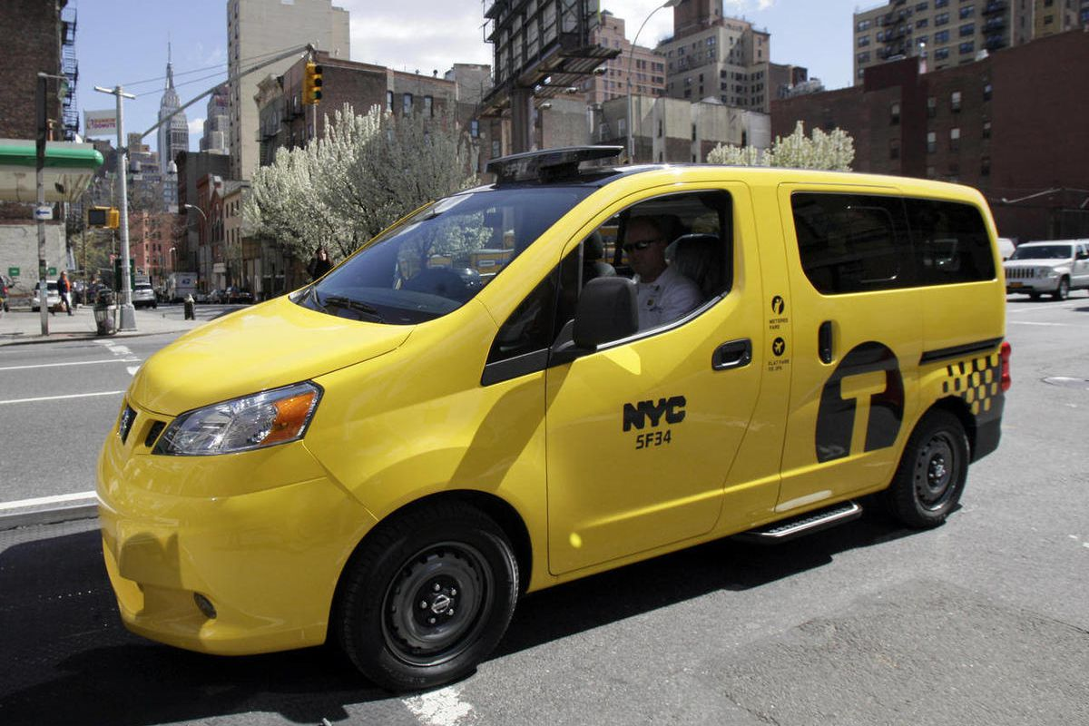 A prototype of the Nissan NV 200 New York City taxi is off-loaded from a truck, in New York, Monday, April 2, 2012. The iconic New York City taxi has gotten a passenger-friendly makeover from Nissan with low-annoyance horns, USB chargers and germ-fighting