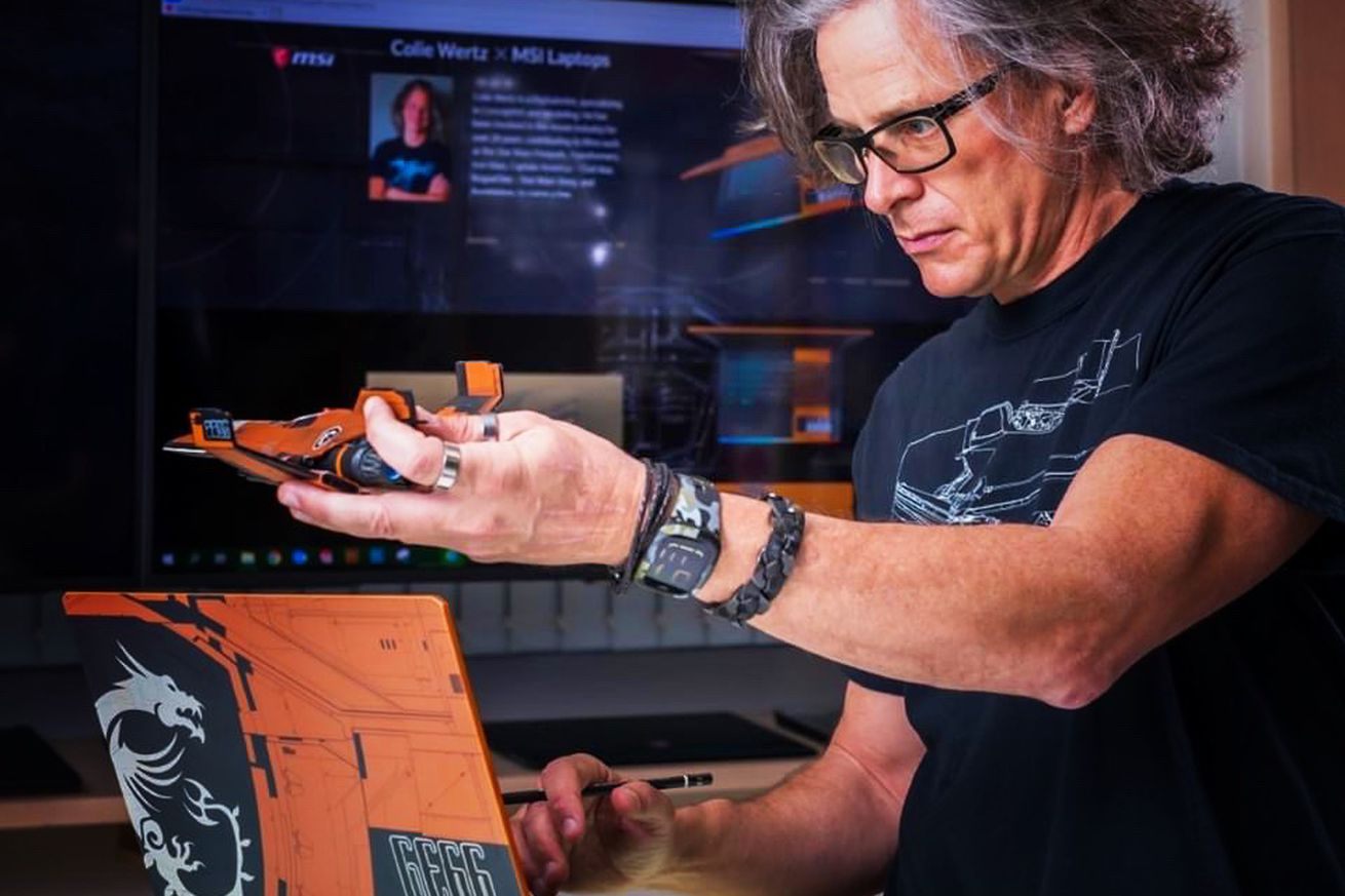 Colie Wertz uses the MSI GE66 Raider Dragonshield Edition while holding a model spaceship.
