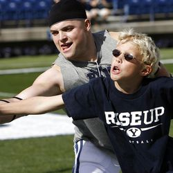 Brandon Ogletree of BYU and Breaker Mendenhall, son of coach Bronco Mendenhall, play keep away before Brigham Young University faces Idaho State in NCAA football in Provo, Saturday, Oct. 22, 2011.