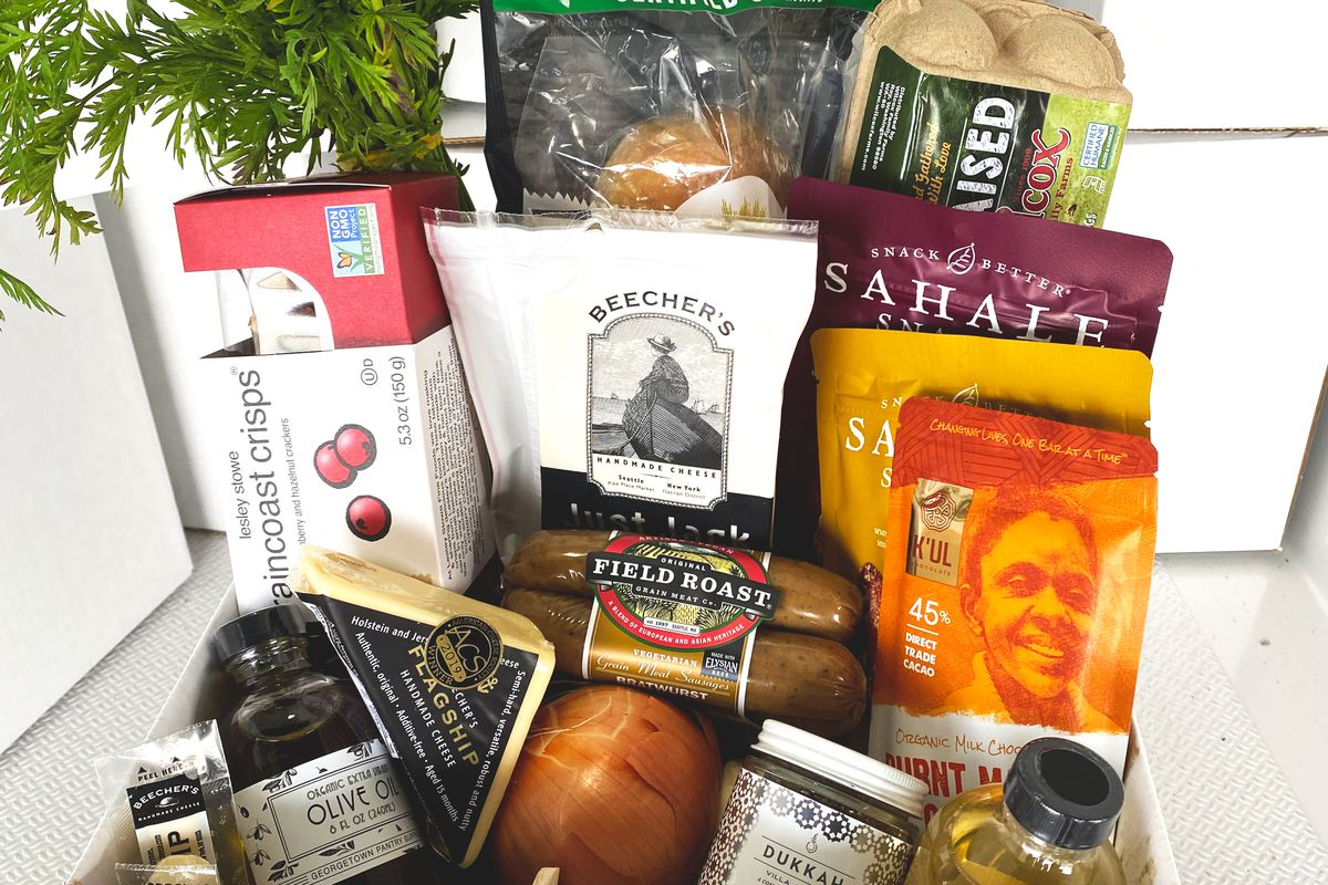 A box of groceries from Homegrown Goods, including drinks and snacks