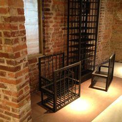 Moveable custom metal wine racks will be used for wine storage upstairs.