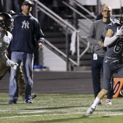 Corner Canyon wide receiver Talmage Handley hauls in a long pass that set up the winning touchdown with two seconds left in the game, giving them a victory over Lone Peak at Corner Canyon High School in Draper on Friday, Sept. 27, 2019.