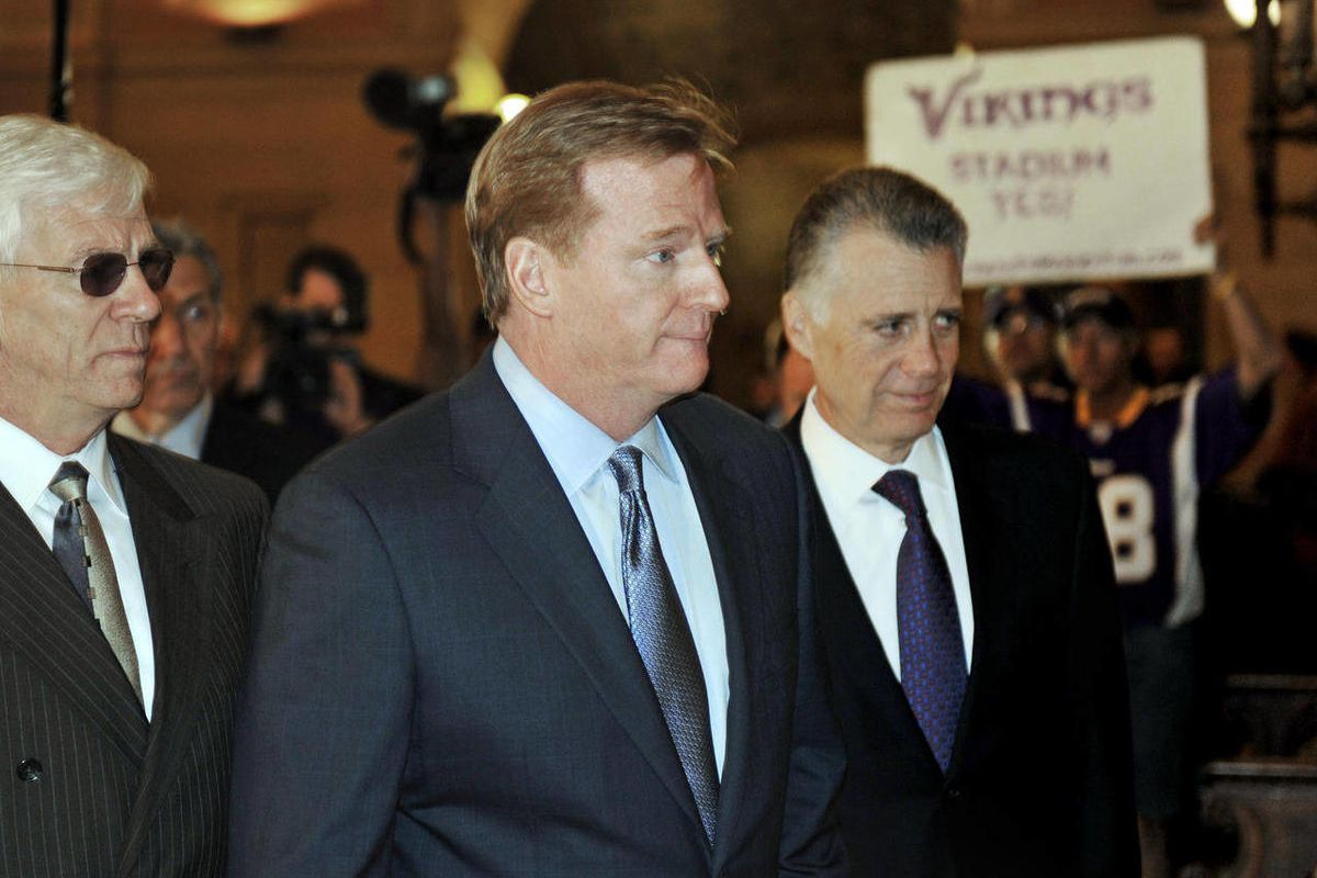 NFL commissioner Roger Goodell, center,  and Pittsburgh Steelers owner Art Rooney, arrive at the Minnesota State Capitol to meet with Gov. Mark Dayton and lawmakers in a push for a new Minnesota Vikings football stadium Friday, April 20, 2012 in St. Paul,