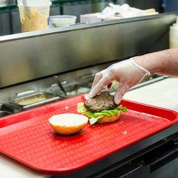 Preparing the signature playska sandwich.