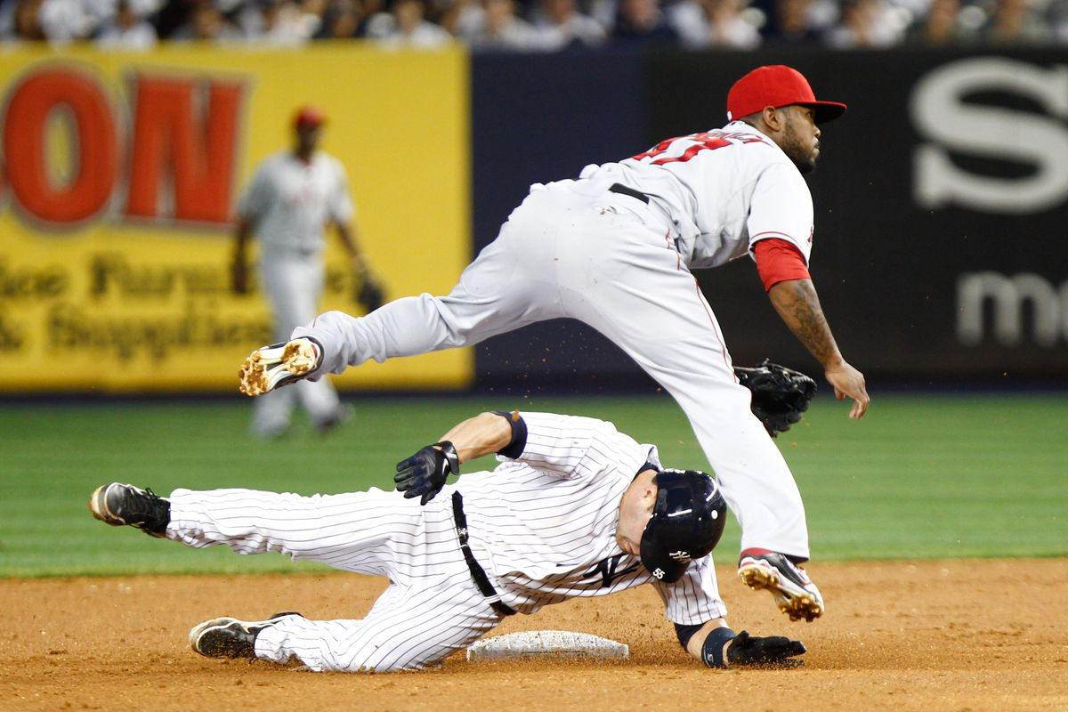 July 13, 2012; Bronx, NY, USA; New York Yankees catcher Russell Martin (55) is forced out by Los Angeles Angels second baseman Howard Kendrick (47) during the fifth inning at Yankee Stadium. Yankees won 6-5. Mandatory Credit: Debby Wong-US PRESSWIRE