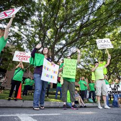 Protesters demonstrate Friday, Aug. 8, 2014, prior to the Utah Board of Education's vote on whether to request an extended waiver from the Adequate Yearly Progress requirements of No Child Left Behind.