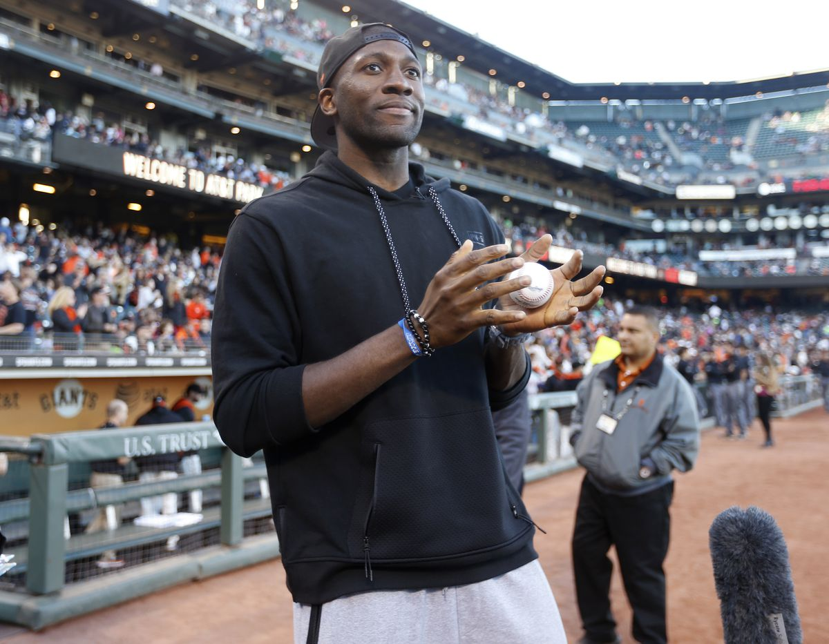 Golden State Warriors' Festus Ezeli (31) prepares to throw out the first pitch before the San Francisco Giants game against the San Diego Padres at AT&T Park in San Francisco, Calif, on Tuesday, June 23, 2015. (Nhat V. Meyer/Bay Area News Group)