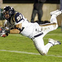 BYU's Micah Alba (22) stretches out for an interception in the end zone to stop CSU's final drive Saturday.