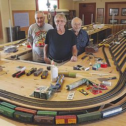 Whistle Stop Railroad Club members (from left) Shawn Lavery, Dave Bacon and Bob Cook stand in the middle of their railroad museum's unfinished centerpiece in Kingman, Ariz., on Sept. 10, 2012. After a decade of dreaming and two years of organizing, the members of the Whistle Stop Railroad Club will open the museum Saturday.
