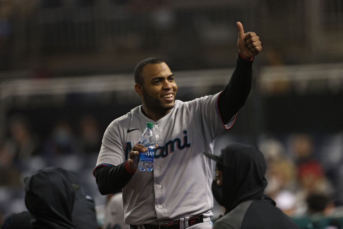 Jesus Aguilar #24 of the Miami Marlins gestures a thumbs up against the Washington Nationals during the third inning at Nationals Park on April 30, 2021 in Washington, DC.