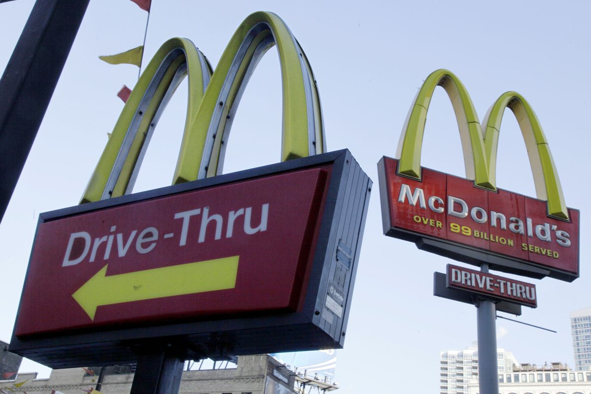 In this Dec. 20, 2010 file photo, McDonald's signs sprout from the restaurant's parking lot in New York.