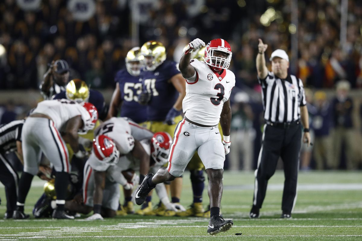 SOUTH BEND, IN:  Georgia Bulldogs linebacker Roquan Smith (3) celebrates a fumble recovered by the Georgia defense during a game against the Notre Dame Fighting Irish offense at Notre Dame Stadium.