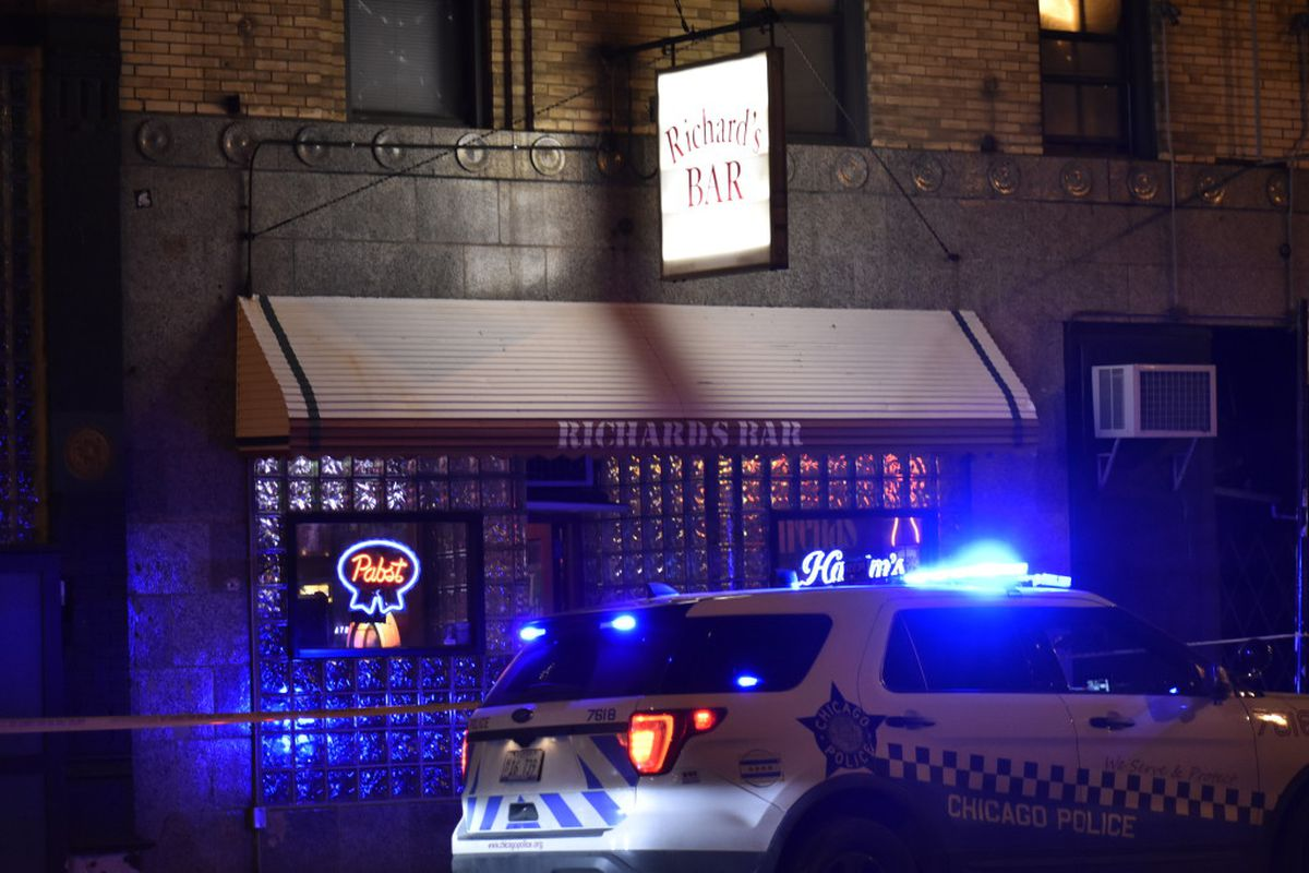 Police investigate the fatal stabbing of a 23-year-old man Friday outside Richard's Bar in West Town.