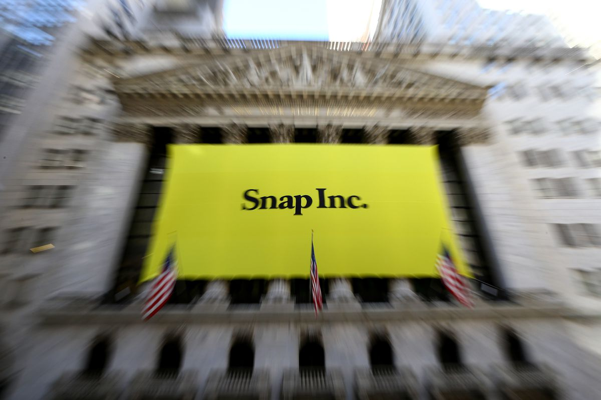 A Snap Inc. banner covers the front of the New York Stock Exchange at Wall Street in New York on March 2, 2017. Snap, the parent company of the popular video social network Snapchat, will price its initial public offering (IPO) at $17 per share, according
