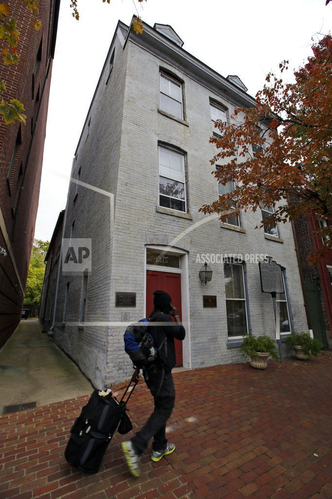 This file photo taken Oct. 31, 2013 shows a person walking past the Freedom House Museum in Alexandria, Va. A historic preservation group is awarding $1.1 million to help support important African-American historic sites.   AP Photo/Alex Brandon, File