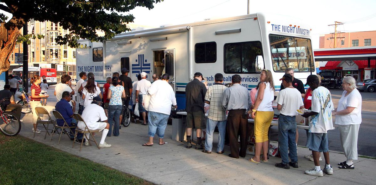The Night Ministry has shorted the time its medical bus stops at locations around Chicago, to reduce the kind of crowding seen here in 2007 in Humboldt Park.