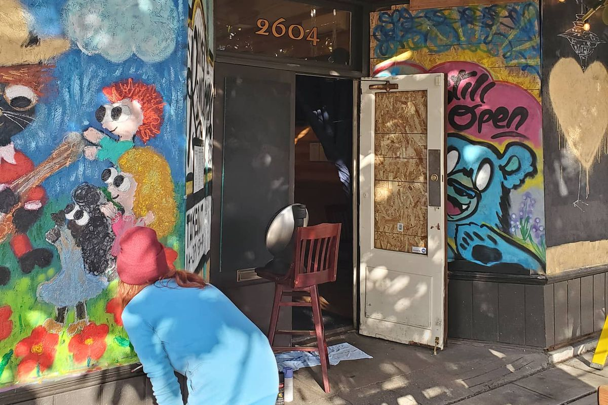 Murals painted across the front of Some Random Bar in Belltown