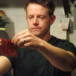 Host Chef Richard Blais holding up his sliceable ketchup.