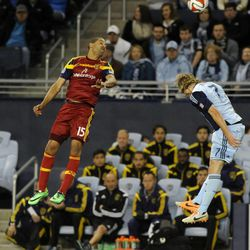 Real Salt Lake's Alvaro Saborio heads the ball over Sporting KC's Chance Myers during a game at Sporting Park in Kansas City, Kan., on Saturday, April 5, 2014.