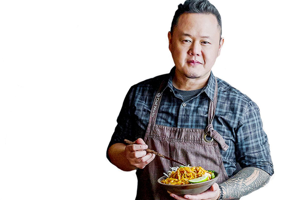 Celebrity chef Jet Tila poses with a bowl of noodles from his new fast casual restaurant, Dragon Tiger Noodle Co.