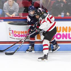 Team USA Forward Jocelyne Lamoureux-Davidson battles with Team Canada Defenseman Renata Fast at Boston's Agganis Arena as part of The Time Is Now tour on Oct 25th, 2017